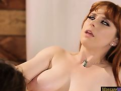 Penny Pax and Carmen Caliente woman-on-woman act of love on massage table